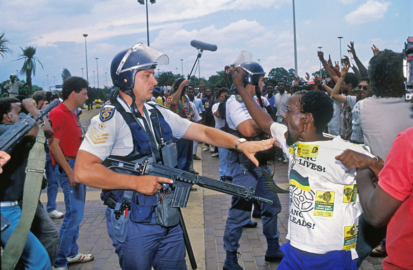 South Africa, Johannesburg. Jan Smuts Airport. 1991. Violence broke out between police and ANC supporters when a large crowd flocked to Jan Smuts Airport to greet Oliver Tambo on his return from exile.