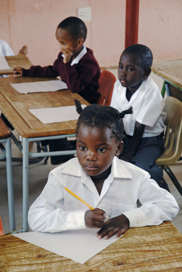 Namibia, (in the desert 30 km inland from Walvis Bay) 2007: Tunaune Tjizembisa (7)  attends school for the first time. J.P. Brand School. She has had to travel over 600 km from a farm and will return home at the end of the term.(Education - International project).