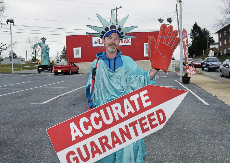 Chris Charlton found the job advertising Liberty Tax consultants while on working parole.