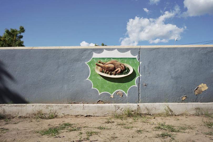 Tete, Mozambique, 05/04/2010. A menu option on a restaurant courtyard wall.