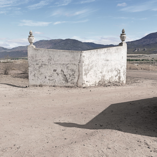 An abandoned farm entrance alongside an expanding township. Clanwilliam, South Africa. 2013.