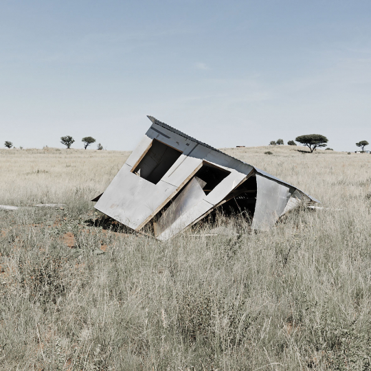 A shack collapsed after residents were removed from land that was sold to them illigally by a person posing as the owner.Walmanthal, north of Pretoria, South Africa. 2012.