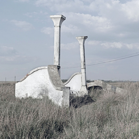 The remains of a abandoned farm entrance gate near an expanding township. Ermelo, South Africa.2011.
