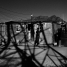 The shadow cast by an electricity pylon falls onto a shack. Cape flats. Cape Town. 2014.