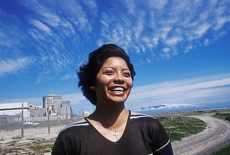 South Africa, Cape Town, Koeberg, 2003: Sonya Genever outside the Koeberg Power Station on the Cape West Coast. (Table Mountain behind). She is the first woman to become a reactor operator in South Africa.