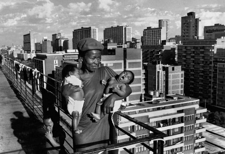 South Africa, Johannesburg, 1992.A woman and her twins on the roof of Hillbrow flats.