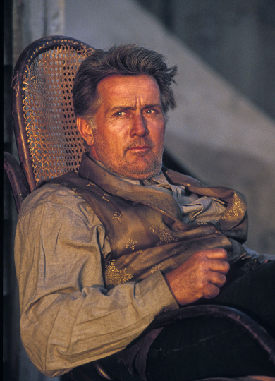 Martin Sheen relaxing during a break in filming. On location, outside Johannesburg. 1996.
