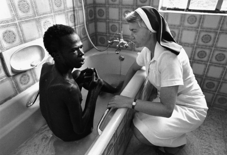 South Africa, Johannesburg. 1991. Sister Cecelia washes Shadrack in the bath.