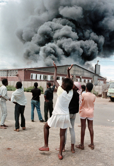 Bophutatswana Homeland, Garankuwa. 1990. A factory is set alight during demonstrations against the Bophutatswana government in Garankuwa.