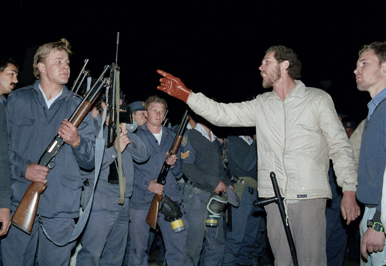 South Africa, Ventersdorp. 1991 Police and white right-wing AWB supporters clash while President F. W. de Klerk speaks to his supporters.