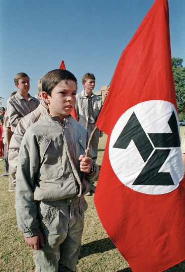South Africa, Welkom. 1990. A young right-wing AWB supporter takes part in a march through Welkom's streets.
