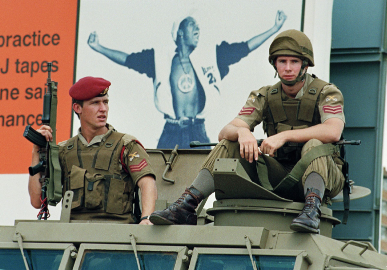 South Africa, Soweto. 1992. Soldiers monitor political activity in Soweto during a period of escalated violence.