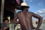 Madagascar, Ilakaka. 2000. A man visits a brothel in shanty town.